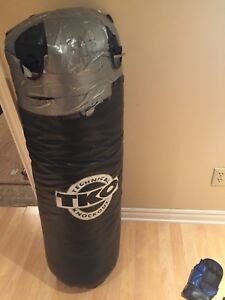 Used punching /kickboxing bag with gloves