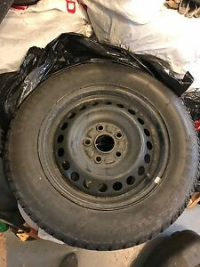 4 Steel rims with 4 Uniroyal Tiger Paw ice and snow II tires