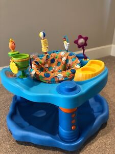 Evenflo exersaucer, bouncy chair and toys