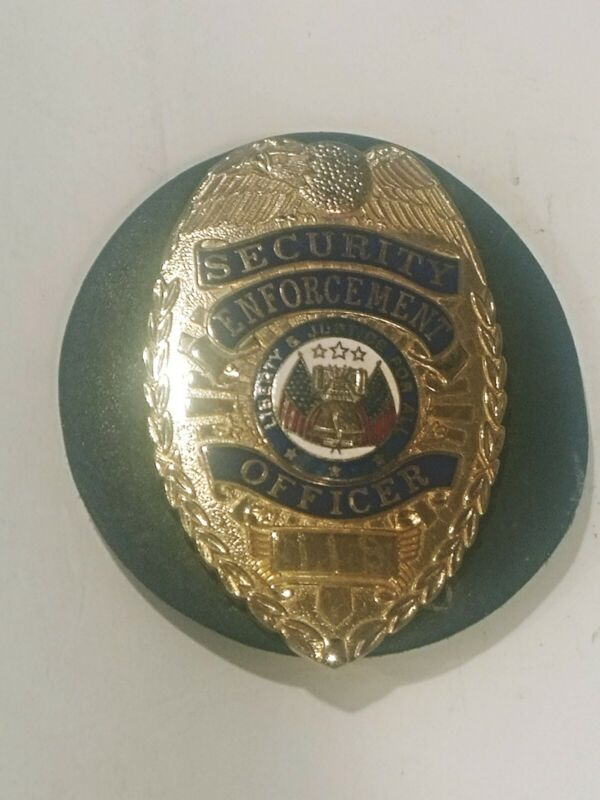 RETIRED COMPANY SECURITY ENFORCEMENT OFFICER / GUARD BADGE GOLD TONE W/ CLIP