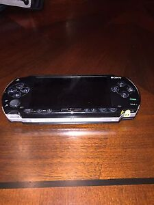 PSP with 5 games/ 2 movies (carrying case)