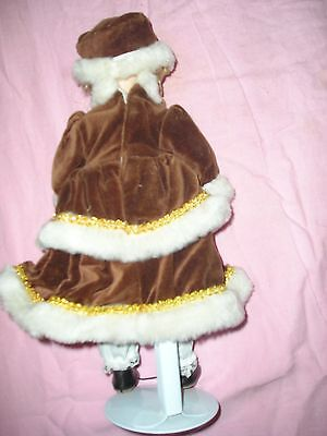 DOLL IN BROWN AND WHITE OUTFIT ON STAND.  CLEAN AND VERY GOOD CONDITION