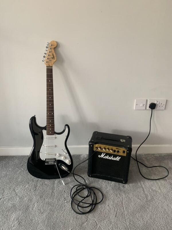 Fender Stratocaster Squier Electric Guitar With Marshall Amplifier