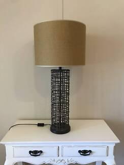 Tall rattan table lamp with natural lamp shade.