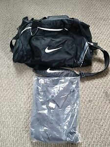 Brand new Nike Gym Bag and Golf Shirt