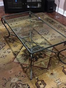 Glass coffee table with wrought rot iron legs must sell