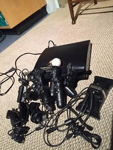 PS3 4 controllers-and numb chucks/video cam eye