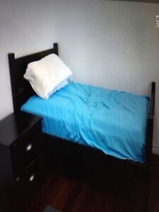 Single bed and side table