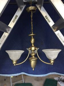 Antique brass coloured three light hanging fixture