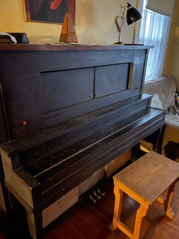 Player Piano with Bench and Music Rolls