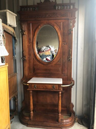 VICTORIAN HALL TREE WITH HOOKS AND BEVELED OVAL MIRROR