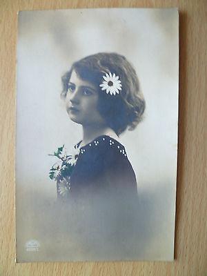 Vintage Postcard- A Fashionable Beautiful Girl Having Flowers on Hair & Dress