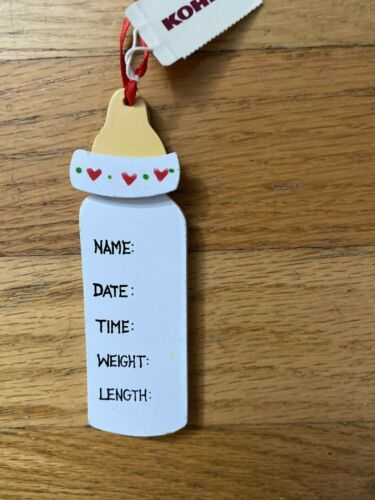 Baby bottle-shaped birth announcement: list name, date, time, weight, and length