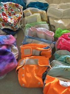 25+ Cloth Diapers, Swim Diapers, Covers and Inserts $75