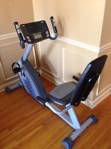 Recumbent exercise bike- has fan & digital display