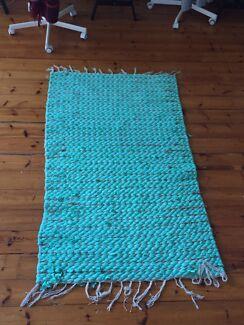 Handwoven aqua turquoise blue rug