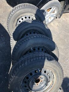 215/70 R16, 4 YOKOHAMA ICEGUARD winter tires with mags..