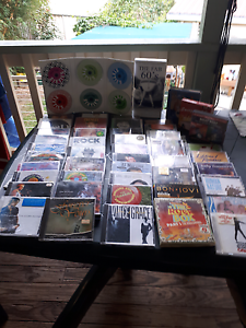 A stack of cd's Berkeley Vale Wyong Area Preview