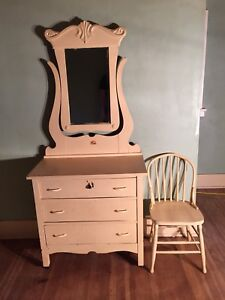 Antique dresser with swivel mirror and matching chair