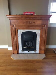Propane fireplace with mantle and hearth