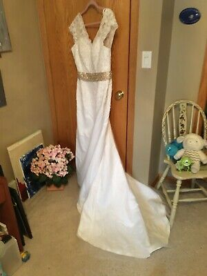 Wedding Dress Size 16 Lace and Chiffon with tan beaded sash and train.