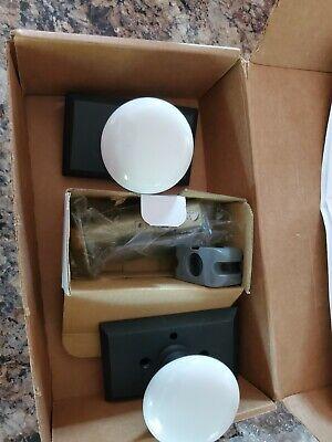 Studio Plate 2-3/8 in.Backset Privacy Bed/Bath White Porcelain Door Knob
