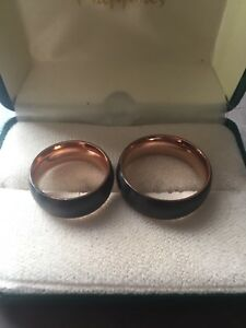 Matching Couples Tungsten Rings•••Both for $90