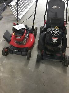 Two push lawn mowers