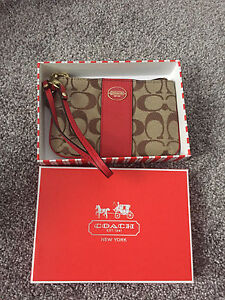 Brand new in box Authentic Coach wristlet