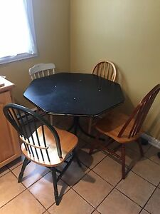 Black octagonal table and 4 chairs