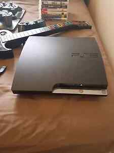 PlayStation 3 500gb + 7 games + guitar + 3 controllers East Perth Perth City Area Preview