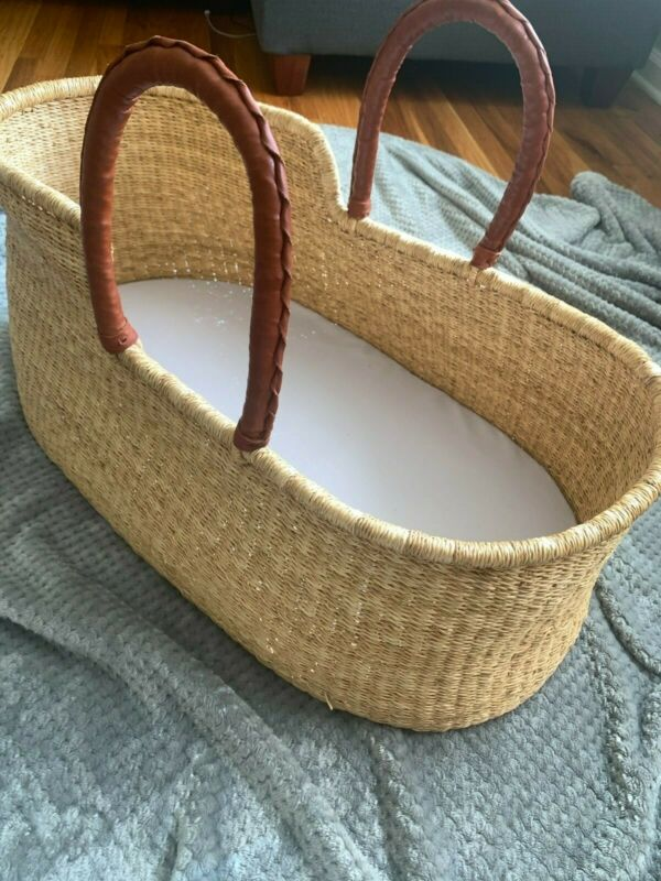 Brand new handwoven Moses basket bassinet with leather handles and pad