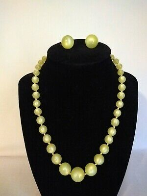 1950s Jewelry Styles and History Vintage 1940s/1950s Yellow Lucite Moonglow Necklace and Earring Set $19.99 AT vintagedancer.com