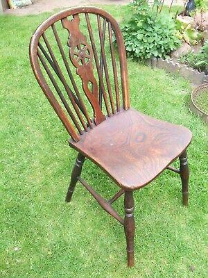 elm seated wheel back chair