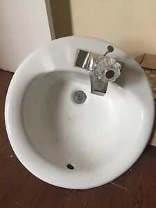 Oval sink with faucet