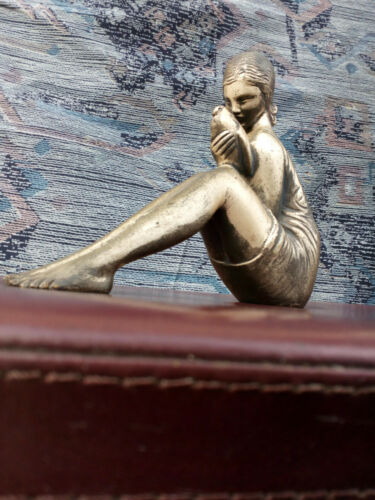 Silvered Bronze figure of girl holding the dove