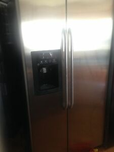 GE Stainless French Door Fridge with Dispenser Excellent working