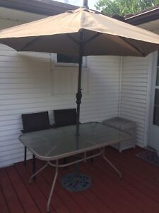 Glass top patio table with canopy