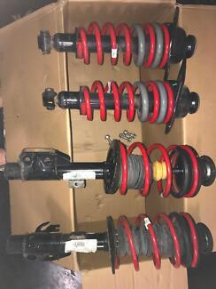 Strut spring suspension