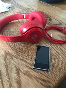 Red Solo 2 beats by Dre headphones and 16 gb 7th gen iPod nano.