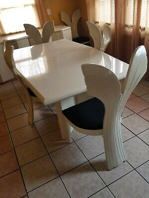 Unique white dining table set, with 6 chairs and a cabinet, material from