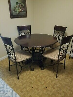 Ashley Furniture round dining room table and chairs set- 4 ()