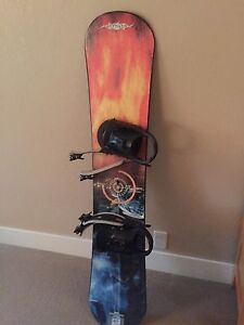 154 snowboard and bindings, men's 5 or women's 6 boots