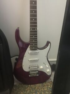 Purple right handed electric guitar