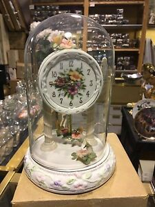 An AVON EXCLUSIVE WEIGHTED TABLETOP HUMMINGBIRD Clock Unused New In Box!!!