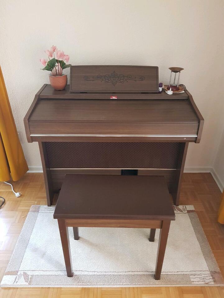 Heimorgel / Elektrische Orgel von National inkl Hocker in Schweighofen