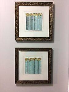2 matching framed blue paintings