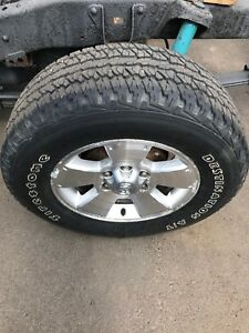 4 Toyota Tacoma rims with rubber