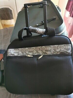 Black Hand Luggage Bag With Wheels And Fold Away Handle