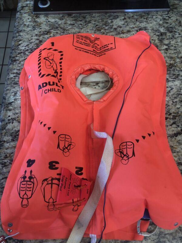 Swissair crewmember life jacket, unused, cO2 powered, opened